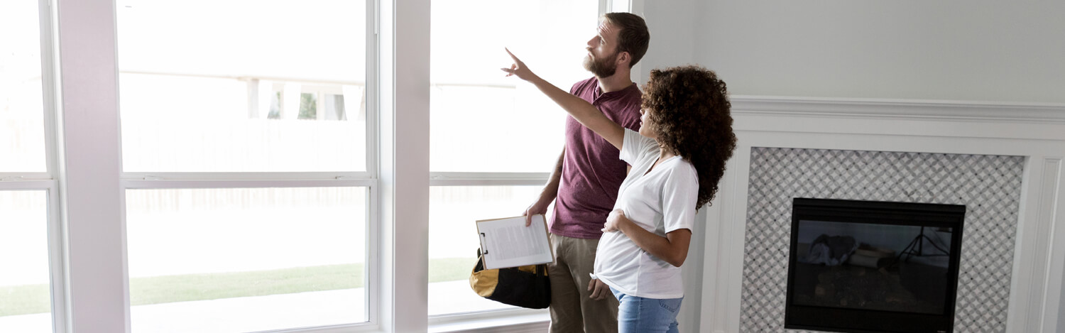 Expectant woman discussing upcoming renovations with a contractor.