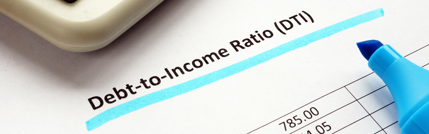 Close-up paperwork of debt to income ratio statement and calculator