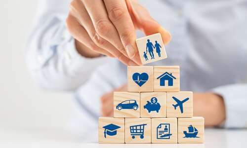 Various icon building blocks representing the different types of insurance