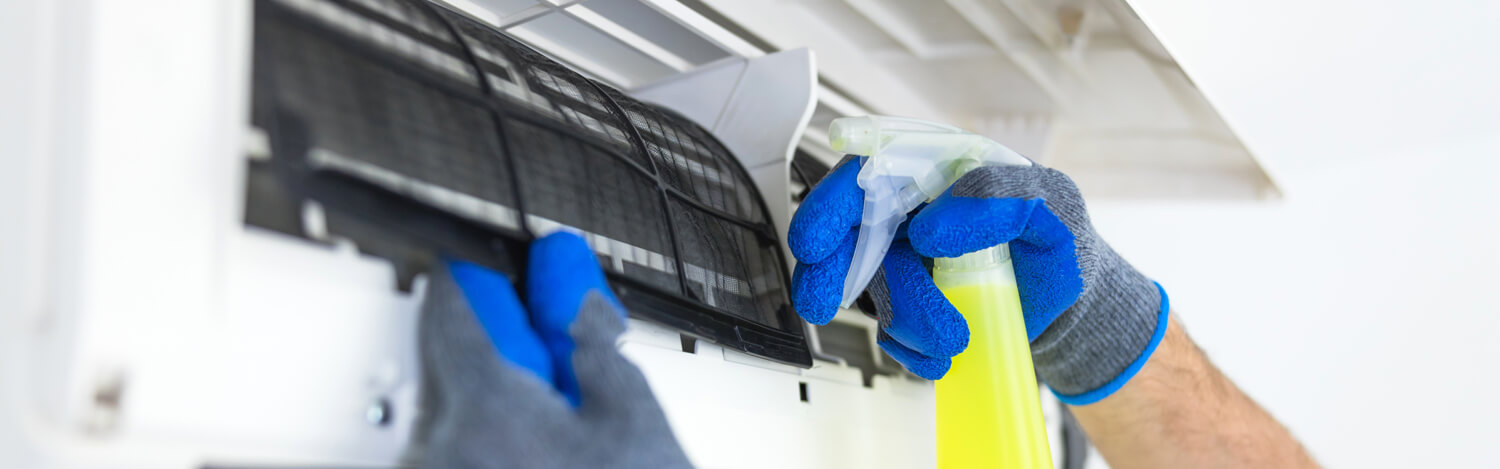 closeup of cleaning an air conditioner filter.